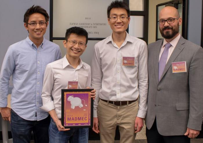 The Fiat Flux team earned the $10,000 first-place prize for its prototype of a self-cleaning water filtration system. Team members pose with Michael Tarkanian (right), a senior lecturer in the Department of Materials Science and Engineering (DMSE...