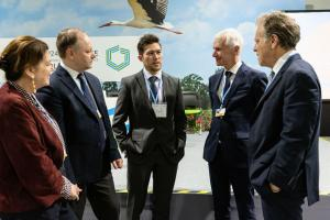 Erik Landry (center) of MIT's Office of the Vice President for Research spoke with British Columbia's climate minister George Heyman (far right) at the COP24 U.N. Climate Change Conference in Katowice, Poland. Joining the conversation were (lef...