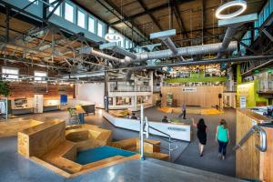 Greentown Labs is the largest clean technology incubator in North America by both square feet and the number of member companies. The open layout of its entrance, shown here, is designed to host events and encourage collaboration.Images:  Barr...