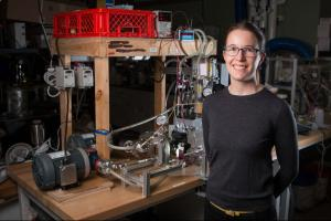 Emily Tow PhD '17, displays equipment she developed to measure the effects of different pressure levels on the way microorganisms build up on membranes used for desalinating water.Courtesy of the researchers