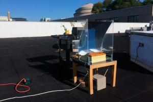 In this experiment, the new steam-generating device was mounted over a basin of water, placed on a small table, and partially surrounded by a simple, transparent solar concentrator. The researchers measured the temperature of the steam produced ove...