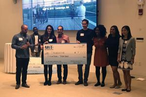 Symbrosia co-founder and CEO Alexia Akbay, second from left, and co-founder and CTO Jonathan Simonds, fourth from right, pose with members of MIT's Water Club following the MIT Water Innovation Prize Thursday.Credit: Zach Winn