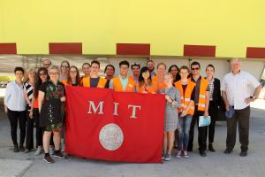 MIT students, students from the University of Venice, and faculty members from both institutions pose in front of Venice's experimental floodgates as part of a collaborative summer workshop. Photo: Lily Keyes
