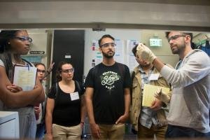 Chemical engineering postdoc Antoni Forner-Cuenca (far right) explains work in the Brushett Lab on advanced flow batteries for grid-level energy storage to 2017 MPC-CMSE Summer Scholars (l-r) Kaila Holloway, Gaetana Michelet, Alexandra Oliveira...