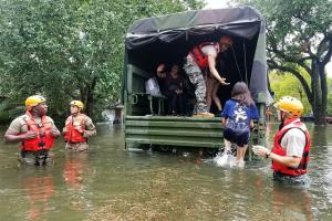 "Texas Army National Guardsmen help Houston residents affected by flooding caused by Hurricane Harvey board a military vehicle. ""With an event like this,"" says MIT associate professor of urban planning Brent Ryan, ""it becomes viscerally evident whic..."