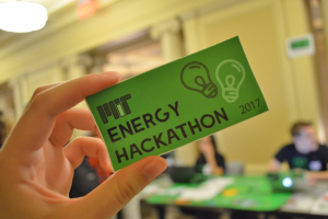 MIT Energy Hackathon leaders handed out stickers at this year's registration tables.Photo: Fatima Husain