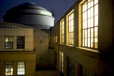 MIT dome at night with lighted windows